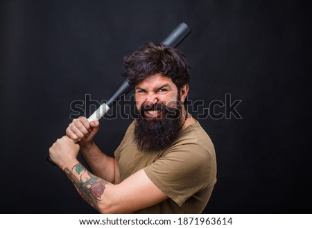 Baseball. Bearded man with baseball bat. Baseball game. Sport bat. Baseball player. Sport game. Sport equipment.