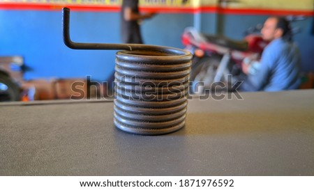 Modern Metal springs and coils of different radius view. Close up, metal heavy rusty iron springs. #1871976592
