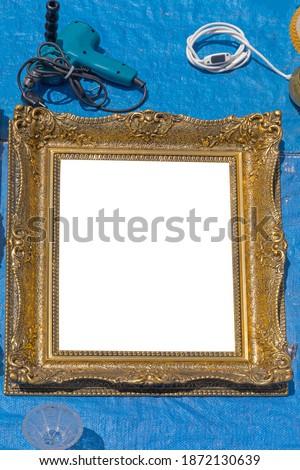 Empty Golden Picture Frame at Tarp Flea Market