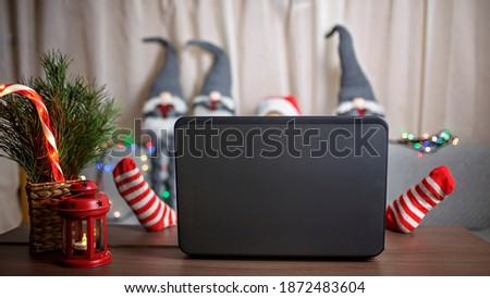 Family Christmas night. Pretty girl sitting on couch and watching movie by laptop at home, family entertainment, festive decoration, childhood and entertainment, indoor lifestyle