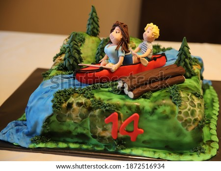 Birthday cake 14 years old two teenagers on a canoe