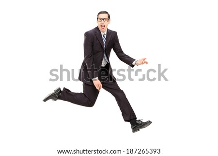 Man in suit playing air guitar isolated on white background #187265393