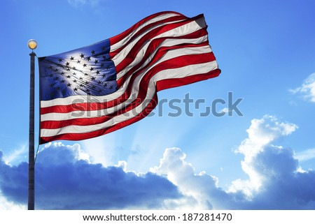 American flag fluttering in the wind under a cloudy sky #187281470
