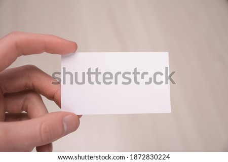 Hand hold blank white card mockup with rounded corners. Plain call-card mock up template holding arm. Plastic credit namecard display front. Check offset card design. Business branding