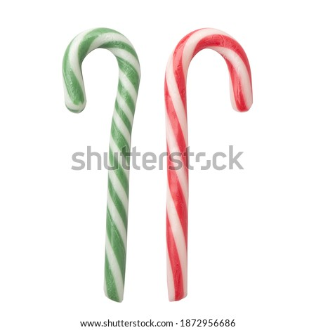striped sugar stick isolated on white background. Traditional Christmas candy, red and green stripe Royalty-Free Stock Photo #1872956686