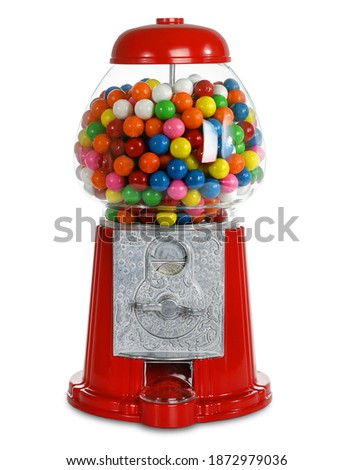 Carousel Gumball Machine.  Glass gum ball dispenser.  Coin Bank.  Bubblegum machines uses quarters.  Fun bright colors.  Isolated White background.   Royalty-Free Stock Photo #1872979036