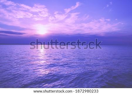 Seascape in early morning, sunrise over the sea. Seashore during sunrise Royalty-Free Stock Photo #1872980233