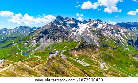 Mountain asphalt road serpentine. Winding Grossglockner High Alpine Road in High Tauern, Austria. Royalty-Free Stock Photo #1872990430