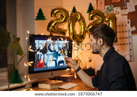 Celebrate New Year's Eve At Home This Year. Host a video call with loved ones. Virtual toast with your friends. Entertainment at remote call and decorate foiled balloons of 2021. #1873006747