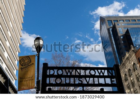 Downtown Louisville signage on the street of Whiskey Row in downtown Louisville Kentucky