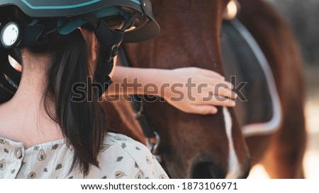 Asian shool kid girl with horse ,riding or practicing horse ridding at horse ranch.