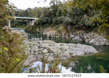 Green waters of Pelorus River flows through the scenic reserves in Marlborough region.  Royalty-Free Stock Photo #1873137829