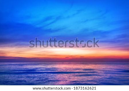 Beautiful pink sunset, blue sky, purple sea background, blurred watercolor sunrise, quiet ocean beach landscape, peaceful morning seascape, idyllic dawn nature, calm soft dusk, gentle sun light glow Royalty-Free Stock Photo #1873162621