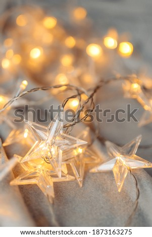Lovely image of star shaped Christmas lights at home. Christmas and New Year concept