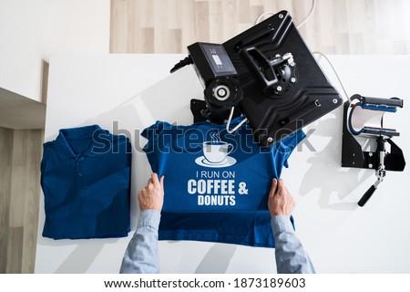 Heat Transfer T Shirt Printing. Tshirt Merchandise Royalty-Free Stock Photo #1873189603