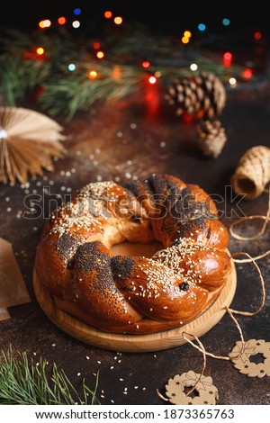 Sweet Bread Wreath. Honey brioche garland with dried berries and nuts. Holiday recipes. Braided Bread.Twist Bread Wreath with poppy seeds and sesame seeds. Christmas Wreath Bread #1873365763