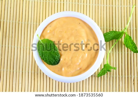 traditional home made ranch dressing with mint herb isolated in bowl Royalty-Free Stock Photo #1873535560