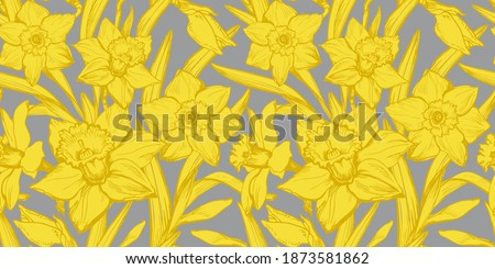 Yellow Illuminating Daffodils Hand Drawn Closeup on Gray Background Ultimate Gray. Floral seamless pattern with silhouettes of narcissus flowers in full bloom for textile, wallpaper, bedding. Royalty-Free Stock Photo #1873581862