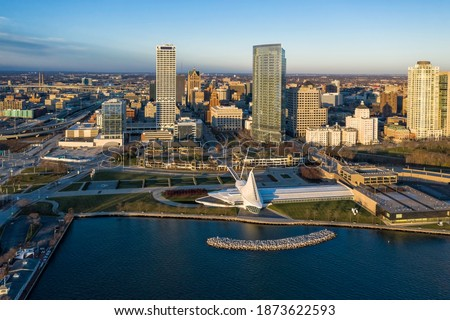 Aerial panorama view of Downtown Milwaukee at sunrise. Tall downtown buildings by the lake
