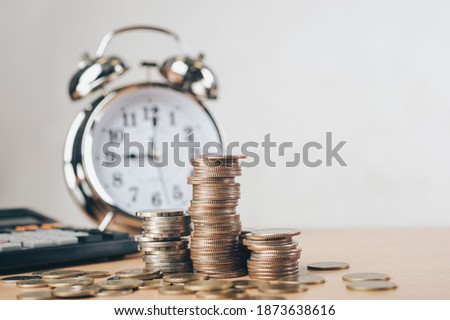 debt collection and tax season concept with deadline remind note, coins, banks, calculator on table, background, time to pay concept. Business and Pay tax concept. Royalty-Free Stock Photo #1873638616