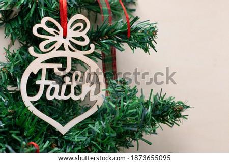 Faith word is hanging on Christmas tree