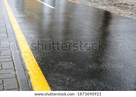 Ice crusted ground, icy road, slippery street, winter weather Royalty-Free Stock Photo #1873690921