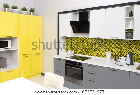 Kitchen interior in yellow colors , illuminating and Ultimate Gray. Royalty-Free Stock Photo #1873731577