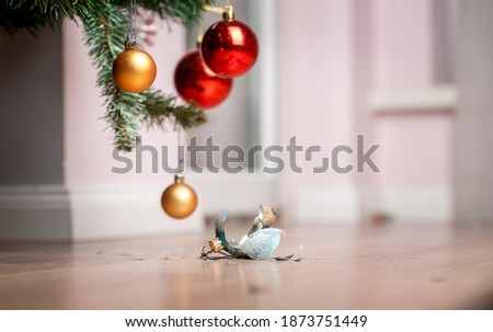 Broken Christmas ball. Fallen to the floor and shattered into pieces. Destroyed remains of glass bauble and different Christmas ornaments. Royalty-Free Stock Photo #1873751449