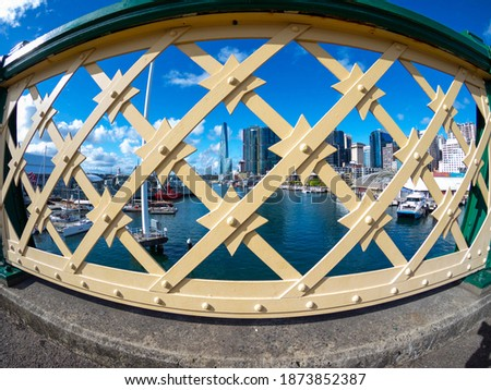 View through bridge fence panels of Darling Harbour and Barangaroo Sydney NSW Australia Royalty-Free Stock Photo #1873852387