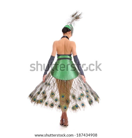 Burlesque dancer with peacock feathers and green dress #187434908
