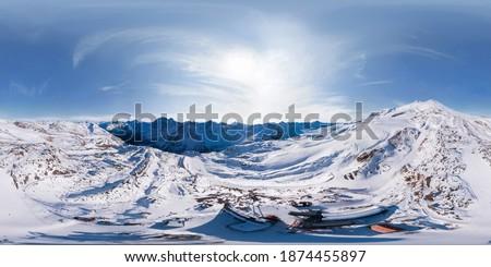360-degree panoramic aerial view of Mount Elbrus MIR station in winter season