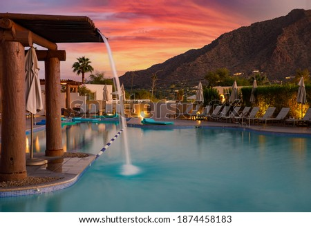 Arizona resort with pool during sunset Royalty-Free Stock Photo #1874458183