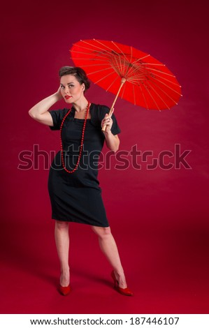 Pinup Girl Poses with Red Umbrella - red background #187446107