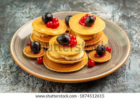 Close up view of fruit pancakes on gray background Royalty-Free Stock Photo #1874512615