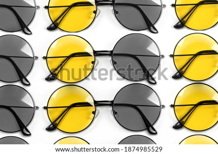 Colors of year 2021. Gray and Yellow.Yellow style glasses isolated on white background.
