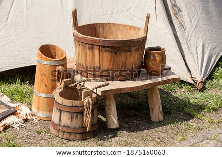 A set of medieval utensils made of wood. Royalty-Free Stock Photo #1875160063