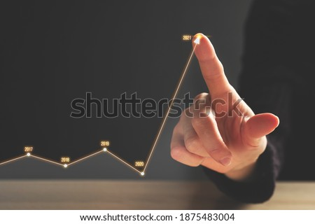 Business growth concept in 2021 with timeline and dynamics. Royalty-Free Stock Photo #1875483004