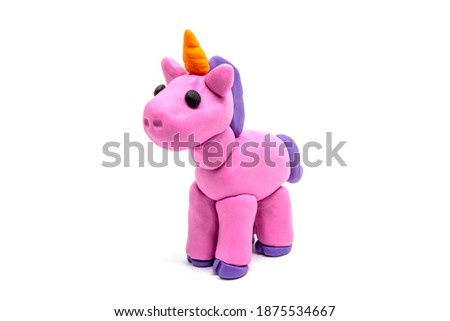 Play dough unicorn on white background. Handmade clay plasticine