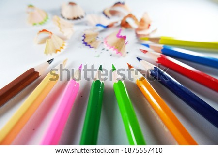 wood color pencils shavings sharpener on isolated white background