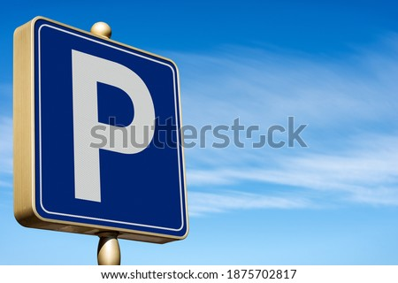 Closeup of a modern Free Parking Sign Road Sign on blue sky with clouds and copy space. Photography.