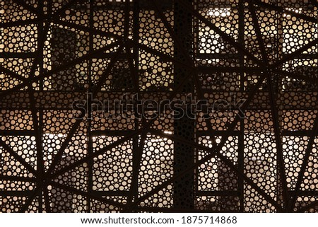 Facade of a modern building. Round geometric patterns. Night shooting Royalty-Free Stock Photo #1875714868