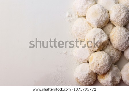 "Selected Focus, Noise Picture of SUgar Dusting putri salju or ""snow princess"" white ball cookies is one of indonesian famous snacks for celebrated ied fitr or ied mubarak"