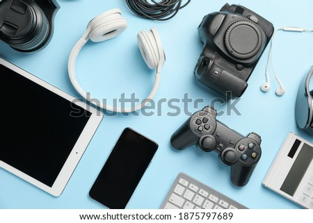 Different modern devices on color background Royalty-Free Stock Photo #1875797689
