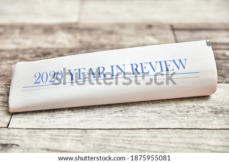 2020 Year in Review on a folded newspaper as the front page Royalty-Free Stock Photo #1875955081