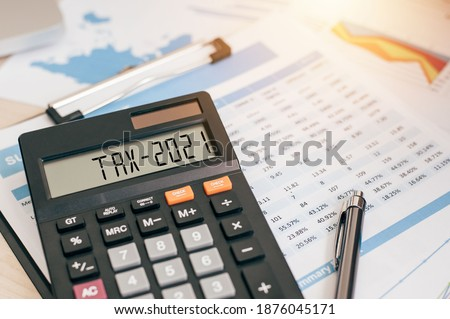 Tax word and 2021 number on a calculator. Business and tax concept. Pay tax in 2021 years. The new year 2021 tax concept Royalty-Free Stock Photo #1876045171