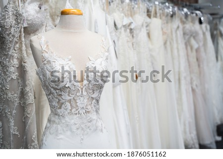 White wedding dresses in a bridal boutique Royalty-Free Stock Photo #1876051162