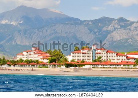 Hotels on seaside of south Turkey and Tahtali mountain near Kemer, Turkey Royalty-Free Stock Photo #1876404139