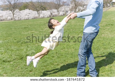 girl playing with father on lawn #187641872