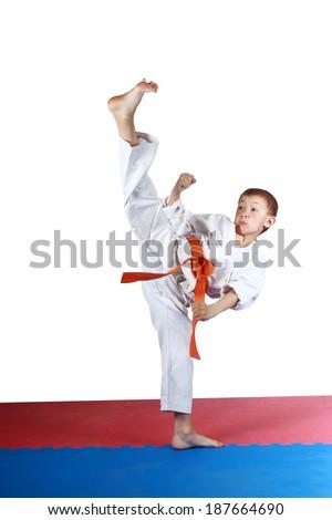Boy in karatege is doing high kick leg #187664690