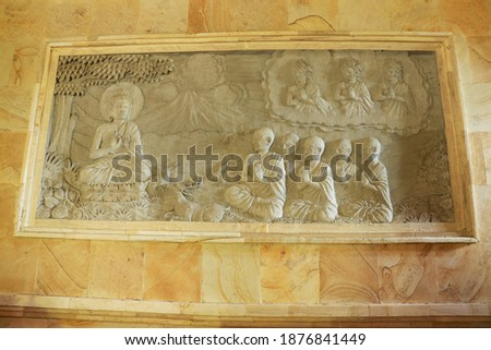 Detail of carved relief at Borobudur on Java, Indonesia. Carved Picture on the wall in buddhist temple, Brahma vihara Arama